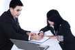 Businesspeople checking business contract
