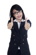 Businesswoman showing thumb up isolated