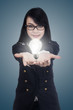 Businesswoman with light bulb