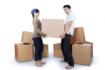 Couple carrying box isolated