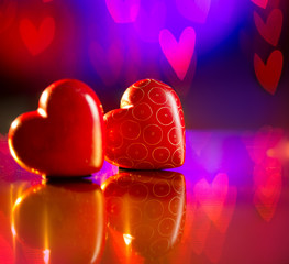 Couple of Valentines Red Hearts over Abstract Purple Background