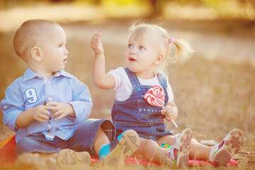 cute boy and girl playing together summer outdoors