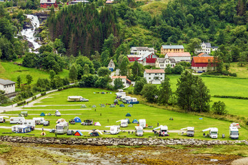 Tourist camping in Norwegian rural town Geiranger, Norway.