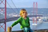 Smiling boy at the bridge