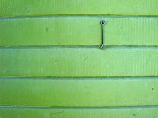 Green wooden wall with hanging hasp
