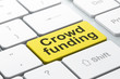 Finance concept: Crowd Funding on computer keyboard background
