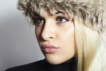 Beautiful Blond Woman in Fur Cap.Beauty Fashion Girl.Winter
