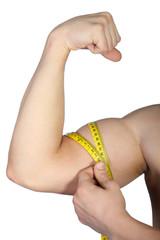 Man measuring his biceps