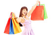 Happy young female in dress holding shopping bags