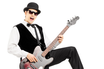 Euphoric man playing a bass guitar