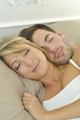 Closeup of sleeping couple in bed