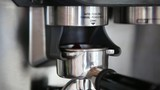 Grinding coffee to make an Espresso