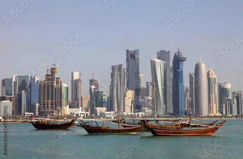 Skyline of Doha with traditional arabic dhows. Qatar