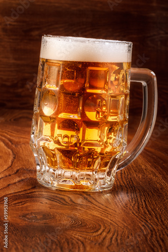 Beer on wood background