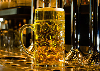 Large glass tankard of draught beer