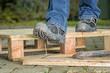 Leinwandbild Motiv Arbeiter mit Sicherheitsschuhen tritt in einen Nagel