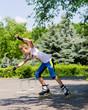 Teenage girl roller blading in a skate park