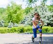 Teenage girl limbering up before skating