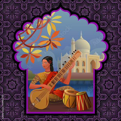 Indian girl playing sitar near Taj Mahal