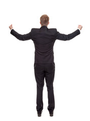 Businessman celebrating with raised arms