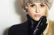 Beauty Fashion Blond Young Woman in Fur Hat.Black Leather Gloves