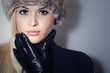 Beauty Fashion Blond Woman in Fur Cap.Black Leather Gloves