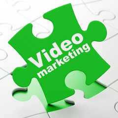 Business concept: Video Marketing on puzzle background