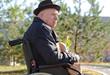 Elderly man in a wheelchair enjoying the sun