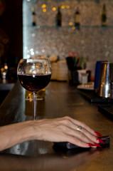 Elegant female hand on a bar counter