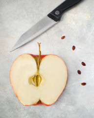 Apple with seeds and knife