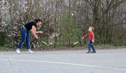 Mother and son playing badminton