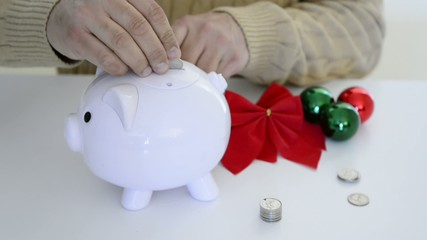 Man saving money for Christmas presents