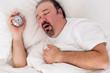Lethargic man yawning as he struggles to wake up