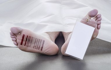 deceased man with a barcode on his foot, with a blank toe tag