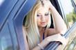 Beautiful young sexy woman near car