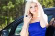 Beautiful young sexy woman near car outdoor