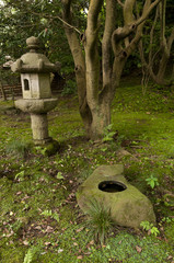 Lantern and rock pond in japaneese garden Sankei-en