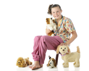 "Young ""vet"" Surrounded by Pets"