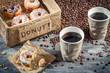 Box full of donuts with coffee for two