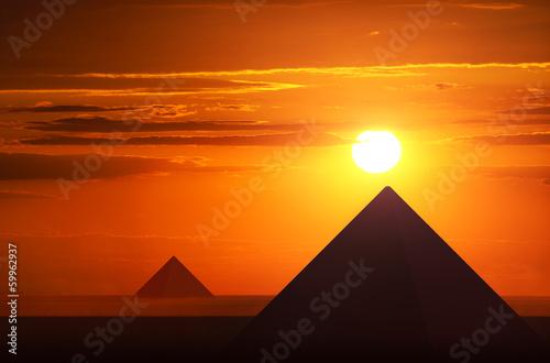 Leinwanddruck Bild Ancient pyramids in sunset