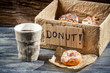Hot coffee and box full of donuts