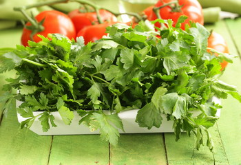 green fresh organic parsley in a wooden box