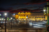 Many street lamps at the Place de la Concorde at night in Paris.
