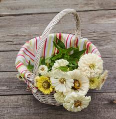 Basket with white zinnia