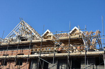 Roof under construction under blue sky