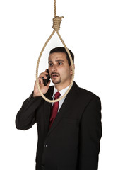 Suicidal businessman contemplating hanging