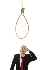 Businessman below a hangmans noose