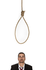 Businessman below a hangmans noose