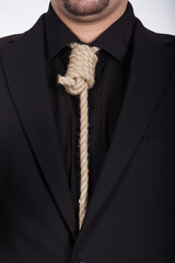Suicidal businessman with noose around his neck