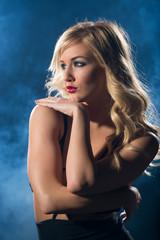 Sensual woman in night dress looking away